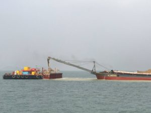 A great amount of sand is leaking from the sand barge